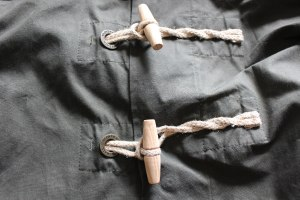 Jute rope and wood toogles are a duffle requirement.