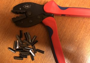 Pliers for hand crimping metal aglets, and the metal aglets.