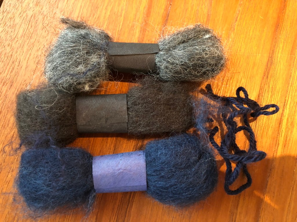 Wool fibres to be mixed and used to fill the hole in the garment.