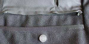 The British Millerain dry wax fabric and wool outer. The secret zippered pocket is just visible.