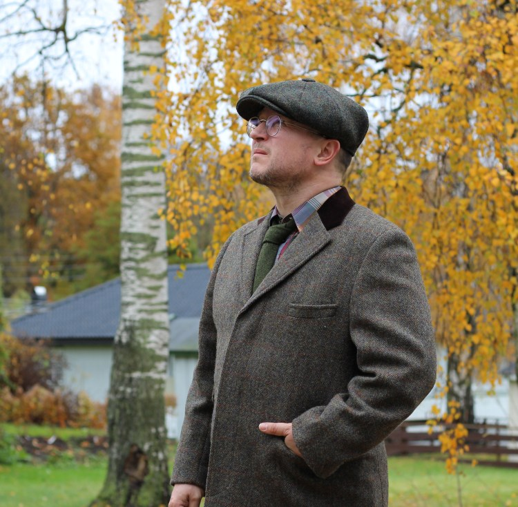The Chelsea Harris tweed coat styled with a Mister Miller Harris tweed cap.