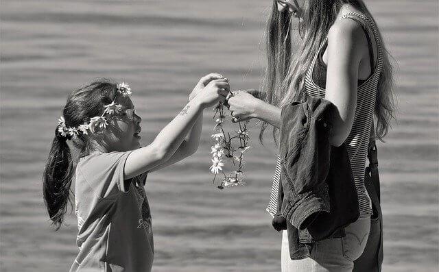 daughter giving mom flower
