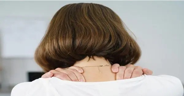 blog picture of woman grabbing her upper back and shoulders