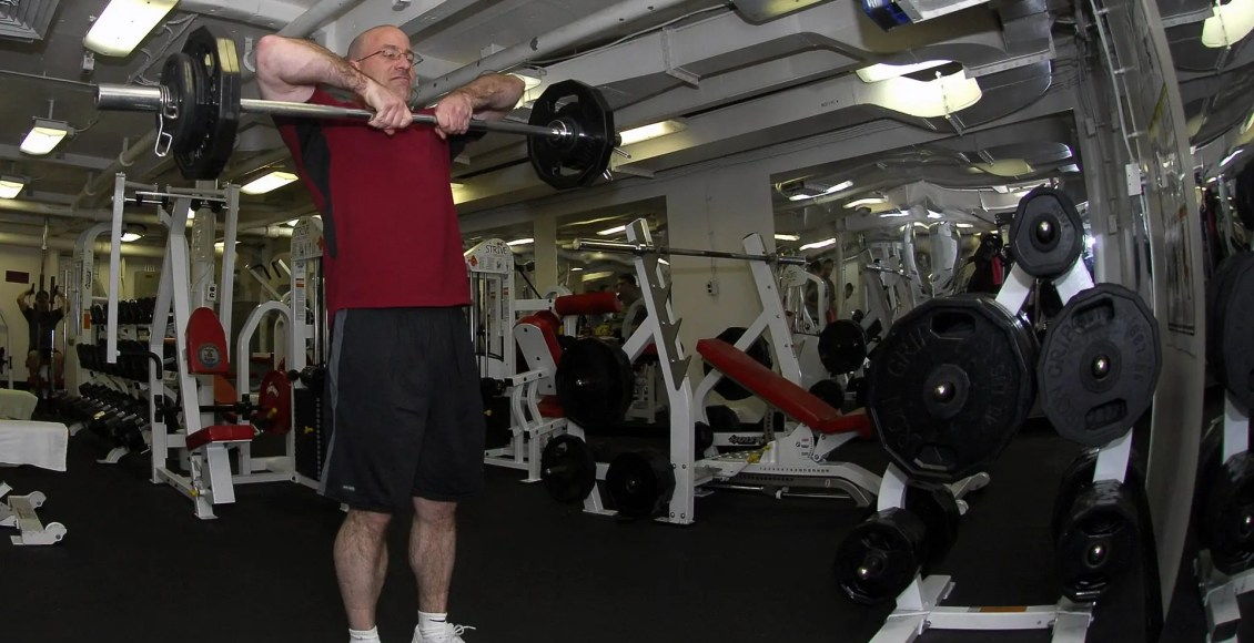 blog picture of older man in gym lifting weights
