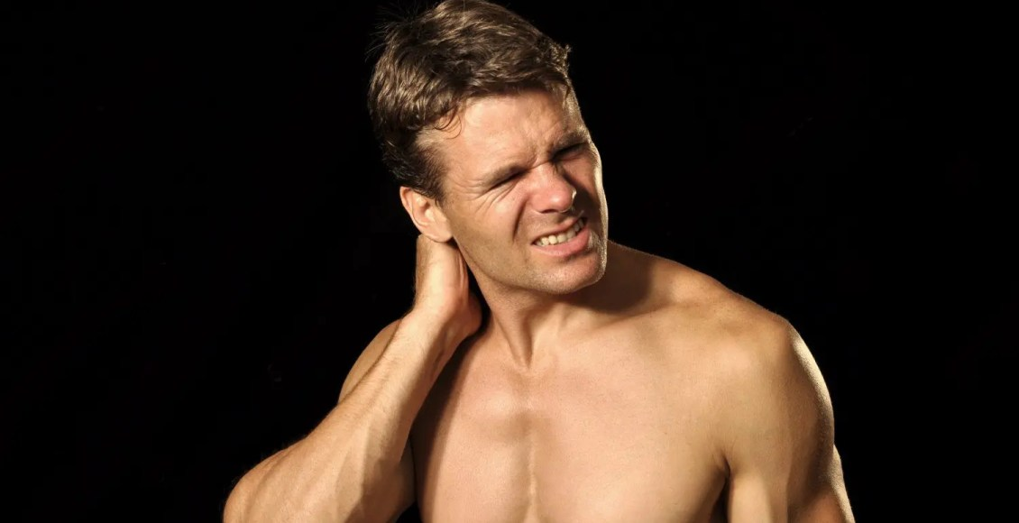 male athlete suffers from acute neck pain