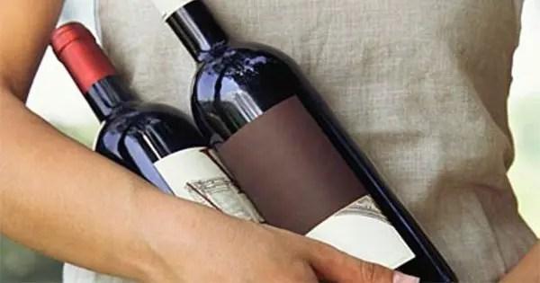 wine bottles being held