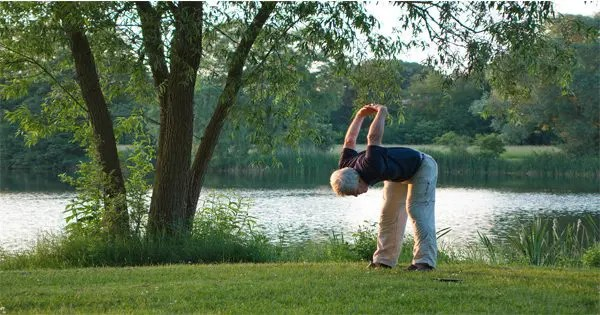blog picture of elderly man doing yoga