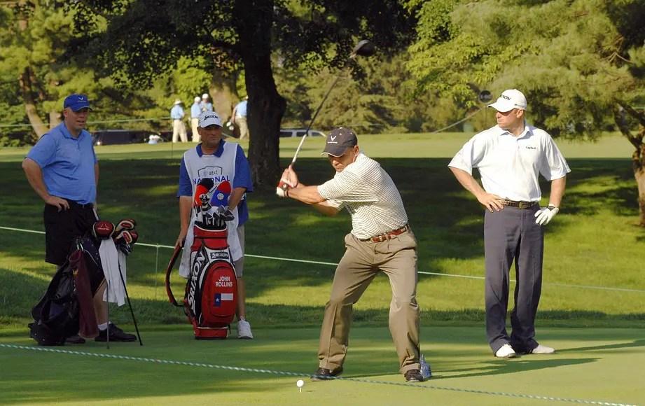 golfers playing round