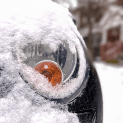 Snow covered car detail