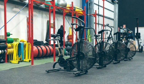 Gym with air bikes and sports equipment