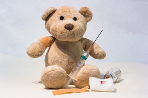 Teddy bear with syringe, gauze and vial of medication. Looking for the best non-bedside nursing jobs?  Check out Dr's Office jobs! They're on this list of the best kept nursing job secrets.