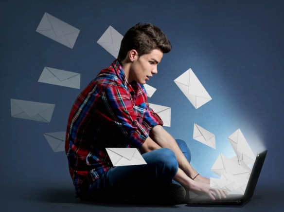 Young man receiving tons of messages on laptop