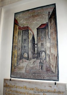 Paintings in an arcade show the area in the medieval period