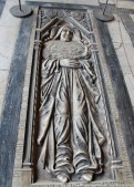 Cool tomb with a peacefully sleeping monk.