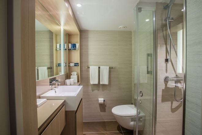 Viking Sky bathroom with oversized shower and heated tile floors.