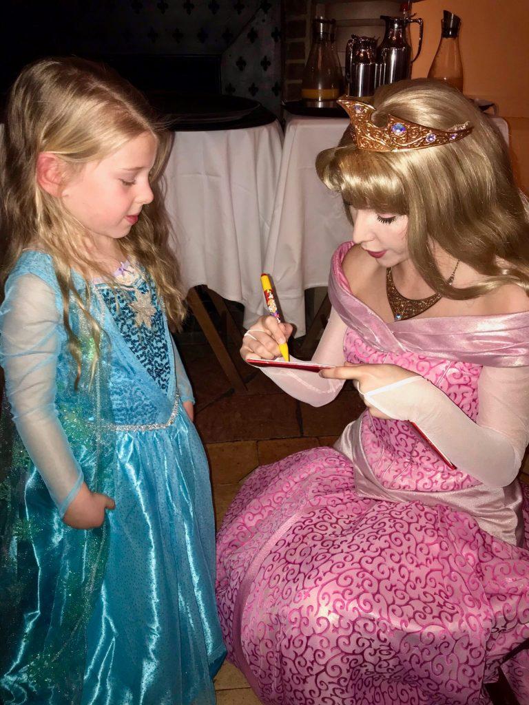Aurora signing autographs at the Princess Breakfast at Disneyland Paris