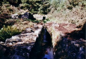 The stream flowing in to the wheel-pit
