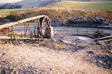 Wheel and buddle, note part of the remains of Cwmystwyth Mill in background