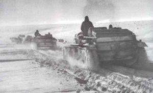 Durch die Schneefelder der Donezfront bei Charkow bahnen sich StuG III Sturmgeschütze den Weg