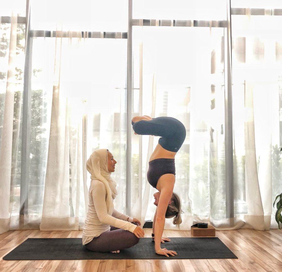 women in hijab doing yoga