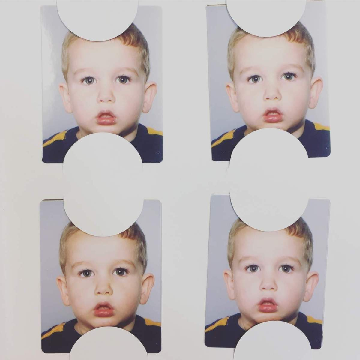 I think his recent passport photos show off his thug side!