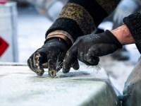 person polishing fiberglass