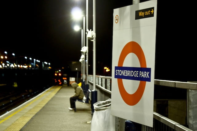 Man on platform of Stonebridge Park station