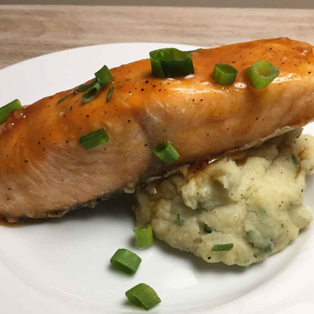 Succulent glazed salmon atop mashed white sweet potatoes