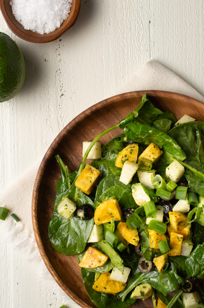 Southwest Spinach Salad (AIP/Paleo) from above with a lime and a small dish of salt to the side