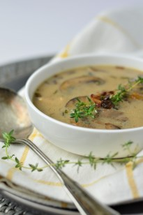 AIP Cream of Mushroom Soup garnished with a sprig of fresh thyme
