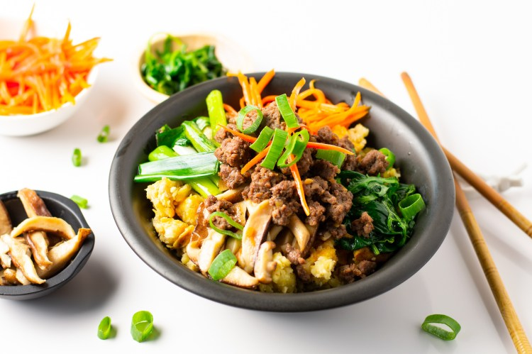 Flavored ground sirloin over colorful veggies and plantain rice