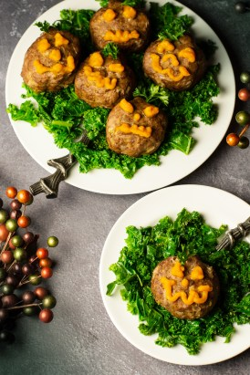 Halloween Mini Meatloaves on a bed of sauteed kale