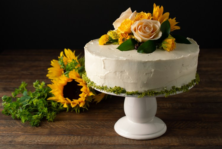 Carrot Cake Everything (AIP/Paleo) expressed as a double decker cake decorated with fall flowers
