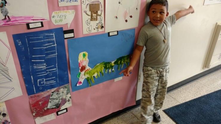 Noah showing me his artwork.