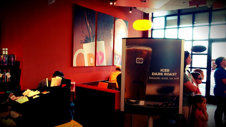 The interior of the new Dunkin Donuts/Baskin-Robbins has a warm, inviting feel to it.