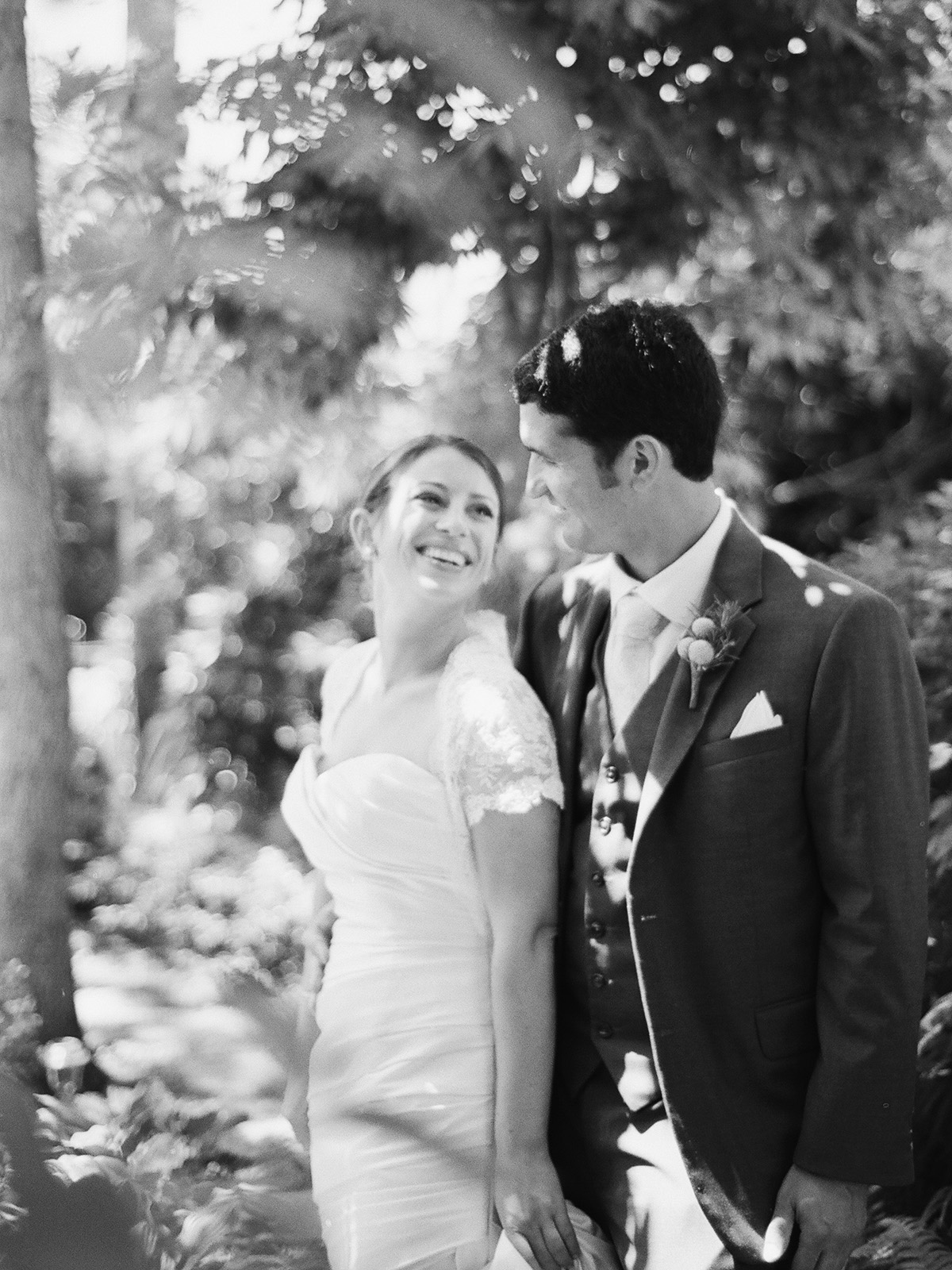 black and white photo of bride gazing at groom