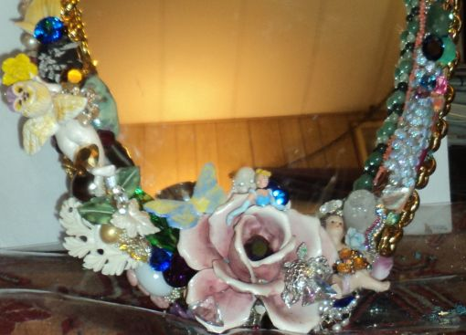 """3' 4"""" tall oval Magical Jeweled Mirror, insanely encrusted with cherubs, angels, jewels, pearls, and more by fashion jewelry designer Wendy Gell. Detail shot #1"""