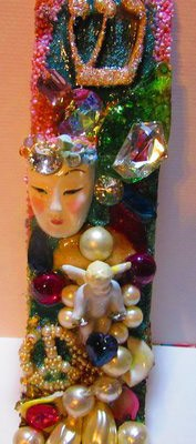 Jeweled Mezuzah : Ornately jewel encrusted mezuzah with Asian face, shin, baby angel and pearl peace sign by fashion jewelry designer by Wendy Gell. $250.00