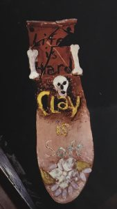 Life is Hard, Clay is Soft - picture of clay wall art with this saying on it by Wendy Gell