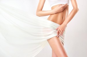 toned healthy body with white curtain