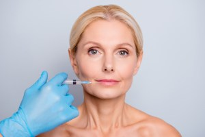 middle aged woman getting dermal filer injections