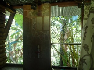 Room with a view. The bathroom looks out over jungle