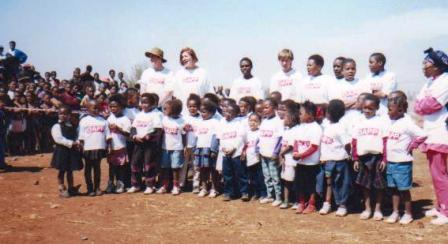 Members of 'One World Choir' visiting a local school in Johannesburg
