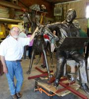 Don Sotille with his bronze sculpture of Marmaduke artist Brad Anderson