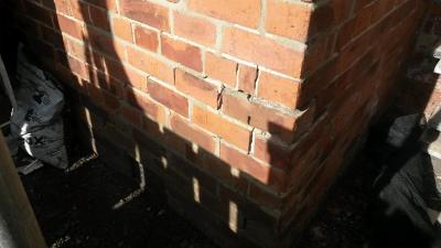 Cracks in brickwork at wall corner