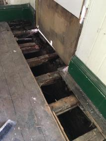 Floor under room 3, rotten and damaged joists