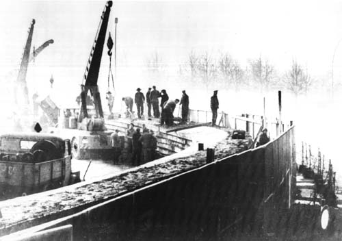 East German construction workers building the Berlin Wall in1961, part of the Iron Curtin