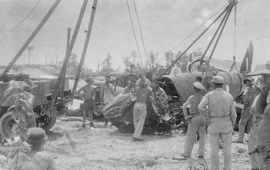 Salvage crew at Morotai airfield retrieving a wrecked Beaufighte