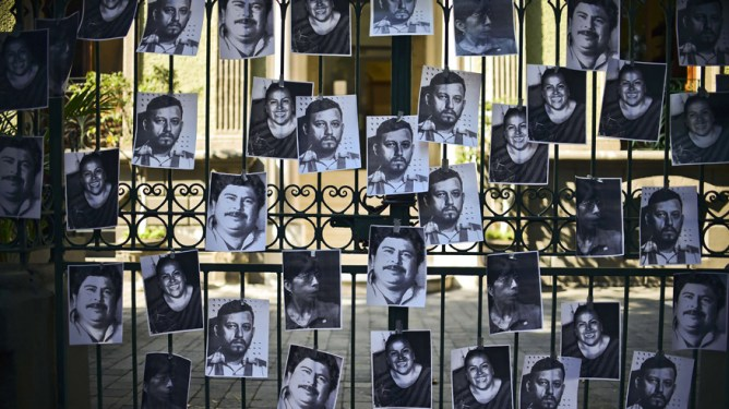 View of photos of killed journalists stuck on the fence of the Veracruz state representation office during a journalists protest in Mexico City on February 11, 2016. Mexican journalist Anabel Flores Salazar's funeral took place Wednesday after she was found killed at a road after being kidnapped Monday in Veracruz state, one of the most dangerous for journalists. AFP PHOTO/RONALDO SCHEMIDT