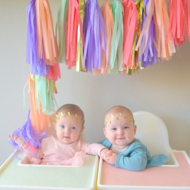 Monthly baby pictures 6 month pictures tassle garland Ikea ANTILOP highchair cover and placemats